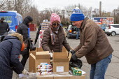 Detroit, Michigan, USA, Coronavirus crisis, The Gleaners Community Food Bank distributing free food to residents in need - Jim West - 2020,2020s,America,Bank,BANKS,charitable,charity,cities,City,communities,Community,contagious,coronavirus,Covid-19,crisis,Detroit,disease,DISEASES,distributing,drive-through,drive-thru,economic,econom