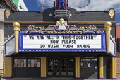 Ferndale, Michigan, USA, We are all in this together Now please go was your hands - A coronavirus message on the Magic Bag theater, closed because of the epidemic - Jim West - 2020,2020s,ACE,architecture,Art Deco,Arts,Bag,bags,buildings,cinema,cities,City,close,closed,closing,closure,closures,communicating,communication,coronavirus,covid-19,crisis,Culture,disease,DISEASES,E