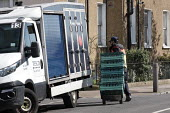 Tesco supermarket food shopping van driver making a delivery, Putney, London - Duncan Phillips - 22-03-2020