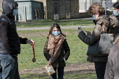Family wearing facemasks posing for a photograph, park, Barnes, London - Duncan Phillips - 2020,2020s,child,CHILDHOOD,children,cities,City,coronavirus,covid-19,disease,DISEASES,epidemic,families,family,female,females,girl,girls,HEA,Health,juvenile,juveniles,kid,kids,Leisure,LFL,LIFE,Lifesty