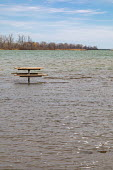 Detroit, Michigan USA. Picnic table far from land, Belle Isle state park. Record high water levels on Detroit River and the Great Lakes have led to shoreline erosion and flooding. - Jim West - 2020,2020s,America,BAD,Belle Isle,cities,City,Climate Change,Detroit,Detroit River,eating food,ENI,environment,Environmental Issues,EXTREME,extreme weather,flood,Flood Plain,flooded,flooding,floods,gl