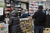Coronavirus pandemic. Pharmacists working in facemasks and disposible gloves, pharmacy, Putney, London - Duncan Phillips - 2020,2020s,bought,buy,buyer,buyers,buying,cities,City,consumer,consumers,coronavirus,covid-19,crisis,customer,customers,disease,DISEASES,drug,drugs,EBF,Economic,Economy,employee,employees,Employment,e