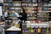 Coronavirus pandemic. Pharmacists working in facemasks and disposible gloves, pharmacy, Putney, London - Duncan Phillips - 23-03-2020