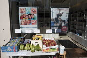 Coronavirus pandemic. Dental Studio selling fruit and vegetables, Putney, London - Duncan Phillips - 2020,2020s,buy,buyer,buyers,buying,cities,City,coronavirus,covid-19,crisis,disease,DISEASES,EBF,Economic,Economy,epidemic,fruit AND vegetables,Grocery Shop,HEA,Health,London,outlet,outlets,pandemic,PE