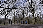 Coronavirus pandemic. Social distancing people taking exercise at a safe distance, Hampstead Heath, London - Stefano Cagnoni - 2020,2020s,alone,cities,City,coronavirus,Covid-19,crisis,disease,DISEASES,epidemic,exercise,exercises,exercising,hazard,hazardous,hazards,HEA,health,Health and Safety,isolated,isolation,London,male,ma