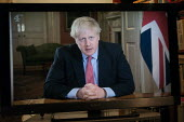 Boris Johnson speaking to the nation on TV, announcing Strict new curbs on life in the UK to tackle the spread of coronavirus - John Harris - 2020,2020s,Boris Johnson,communicating,communication,CONSERVATIVE,Conservative Party,conservatives,coronavirus,covid-19,disease,DISEASES,epidemic,HEA,Health,home,homes,male,man,men,MP,MPs,pandemic,peo