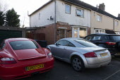 Sports cars infront of a dilapidated house, Stratford Upon Avon, Warwickshire. Red Porsche 718 Cayman, Audi TT Sport - John Harris - 2020,2020s,aspiration,AUTO,AUTOMOBILE,AUTOMOBILES,car,cars,commodities,commodity,dilapidated,garage,garages,goods,hobbies,hobby,hobbyist,house,houses,Housing,Leisure,LFL,LIFE,Low Income,park,parked,pa