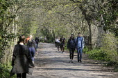 Coronavirus pandemic, Walkers and joggers social distancing whilst exercising, Thames footpath, London - Duncan Phillips - 26-03-2020