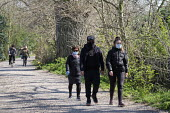 Coronavirus pandemic, Walkers social distancing whilst exercising, Thames footpath, London - Duncan Phillips - 2020,2020s,access,activities,cities,City,coronavirus,covid-19,crisis,disease,DISEASES,epidemic,exercise,exercises,exercising,face mask,face masks,FEMALE,footpath,footpaths,Leisure,LFL,LIFE,lockdown,Lo