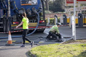Emergency tank cleaning, Shell petrol station Stratford Upon Avon, Warwickshire. Jogger exercising - John Harris - 27-03-2020