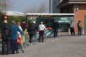 Coronavirus pandemic, Queuing shoppers, Morrisons supermarket, Stratford Upon Avon, Warwickshire - John Harris - 2020,2020s,age,ageing population,bought,buying,consumer,consumers,coronavirus,covid-19,crisis,customer,customers,disease,DISEASES,EBF,Economic,Economy,elderly,epidemic,FEMALE,groceries,lockdown,male,m