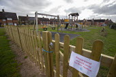 Coronavirus Pandemic. Closed children's play area, housing estate, Stratford Upon Avon, Warwickshire - John Harris - 31-03-2020