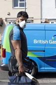 Coronavirus pandemic, British Gas Engineer with face mask, home heating repair, Stratford Upon Avon, Warwickshire - John Harris - 31-03-2020