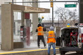 Detroit, Michigan USA, Coronavirus pandemic. Workers disinfecting a mass transit shelter - Jim West - 2020,2020s,America,cities,City,clean,cleaner,cleaners,cleaning,cleansing,contagious,coronavirus,covid-19,Detroit,disease,DISEASES,disinfect,disinfecting,EARNINGS,employee,employees,Employment,empty,ep