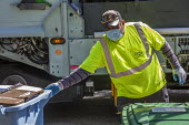 California, USA. Worker driving a lorry picking up recycled trash for the Ecology Center. He works in an essential job - David Bacon - 2020,2020s,America,bin man,bin man binmen,bin men,binman,binmen,California,cities,City,collection,collector,coronavirus,council service,COUNCIL SERVICES,covid-19,disease,DISEASES,DRIVER,DRIVERS,drivin