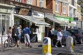 Coronavirus pandemic, People shopping in the sunshine, causing problems in social distancing, Barnes, London - Duncan Phillips - 05-04-2020