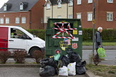 Coronavirus pandemic, van driver, closed clothing recycling bin and elderly shopper, Stratford Upon Avon, Warwickshire - John Harris - 2020,2020s,apparel,bin,bins,charitable,charity,close,closed,closing,closure,closures,clothes,clothing,coronavirus,covid-19,customer,customers,deliveries,delivering,delivery,disease,DISEASES,driver,dri