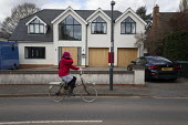 Coronavirus Pandemic. Elderly cyclist covering face, Stratford Upon Avon, Warwickshire - John Harris - 2020,2020s,AFFLUENCE,AFFLUENT,age,ageing population,bicycle,bicycles,BICYCLING,Bicyclist,Bicyclists,BIKE,BIKES,Bourgeoisie,coronavirus,covid-19,cycle,cycles,cycling,cyclist,Cyclists,disease,DISEASES,E