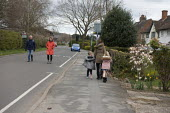 Coronavirus Pandemic. Walkers exercise in the street, Stratford Upon Avon, Warwickshire - John Harris - 02-04-2020