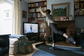 Coronavirus Pandemic. Pilates trainer giving a lesson over the internet. Woman exercising at home, Stratford Upon Avon, Warwickshire - John Harris - 02-04-2020