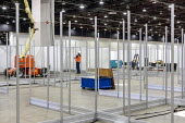 Detroit, Michigan USA Coronavirus Pandemic. Workers constructing an emergency field hospital at the TCF convention center. The 1,000-bed hospital will care for Covid-19 patients - Jim West - 02-04-2020