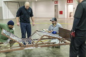 Detroit, Michigan USA Coronavirus Pandemic. Workers constructing an emergency field hospital at the TCF convention center. The 1,000-bed hospital will care for Covid-19 patients Workers learning how t... - Jim West - 02-04-2020