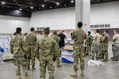 Detroit, Michigan USA Coronavirus Pandemic. Workers constructing an emergency field hospital at the TCF convention center. The 1,000-bed hospital will care for Covid-19 patients Soldiers from the Army... - Jim West - 02-04-2020