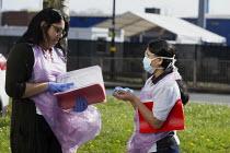 Coronavirus pandemic. Health workers in discussion before visiting sick at home, Century Tower, Edgbaston, Birmingham - John Harris - 07-04-2020