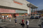 Coronavirus Pandemic. Customers queuing maintianing social distance, Sainsbury's Supermarket, Finchley Road, London - Philip Wolmuth - 2020,2020s,bought,buy,buyer,buyers,buying,car park,cities,City,consumer,consumers,coronavirus,covid-19,customer,Customers,disease,DISEASES,epidemic,FEMALE,highway,London,male,man,men,outlet,outlets,pa