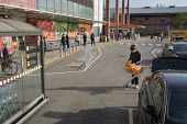 Coronavirus Pandemic. Customers queuing maintianing social distance, Sainsbury's Supermarket, Finchley Road, London - Philip Wolmuth - 07-04-2020