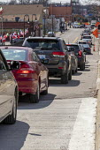 Detroit, Michigan USA. Coronavirus Pandemic, long line of cars queuing at Gleaners Community Food Bank which is distributing free food to locals in need - Jim West - 08-04-2020