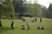 Coronavirus pandemic. social distancing during the coronavirus pandemic, Golders Hill Park, Hampstead Heath, London - Philip Wolmuth - 2020,2020s,child,CHILDHOOD,children,cities,City,cityscape,cityscapes,Coronavirus pandemic,Covid-19,desease,disease,DISEASES,families,family,Hampstead Heath,HEA,Health,infection,infectious,juvenile,juv