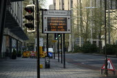 Coronavirus pandemic. Road sign warning Essential Travel Only Stay At Home Save Lives, deserted streets, Bristol - Sam Morgan Moore - 11-04-2020