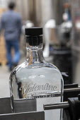 Michigan USA. Coronavirus Pandemic. Valentine Distilling Co. producing and bottling hand sanitizer. The distillery has shut down its production of bourbon, gin, and vodka to make hand sanitizer - Jim West - 2020,2020s,alcohol,America,bottle,bottles,bottling,capitalism,cities,City,coronavirus,covid-19,craft distillery,Detroit,disease,DISEASES,disinfectant,distillery,epidemic,FACTORIES,factory,Ferndale,Han