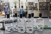 Michigan USA. Coronavirus Pandemic. Valentine Distilling Co. producing and bottling hand sanitizer. The distillery has shut down its production of bourbon, gin, and vodka to make hand sanitizer - Jim West - 13-04-2020