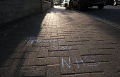 Coronavirus pandemic, Thank you NHS chalked on the pavement, Wandsworth, London - Duncan Phillips - 11-04-2020