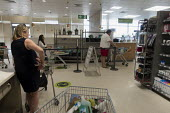 Coronavirus pandemic. Social distancing, queuing for the checkout, Waitrose Supermarket, Stratford Upon Avon, Warwickshire - John Harris - 11-04-2020
