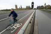 Coronavirus pandemic. Empty streets, Bank Holiday Monday with no tourists, Westminster Bridge,Houses of Parliament, London - Jess Hurd - 2020,2020s,Bank,Bank Holiday,BANKS,bicycle,bicycles,BICYCLING,Bicyclist,Bicyclists,BIKE,BIKES,bridge,bridges,cities,City,coronavirus,covid-19,cycle,cycle lane,cycles,cycling,Cyclist,Cyclists,disease,D