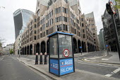 Coronavirus pandemic. Empty Police box, Bank Holiday Monday deserted streets, City of London, London - Jess Hurd - 2020,2020s,adult,adults,Bank,Bank Holiday,BANKS,box,boxes,cities,City,City of London,coronavirus,covid-19,deserted,disease,DISEASES,Empty,epidemic,HEA,Health,Holiday,holiday maker,holiday makers,holid