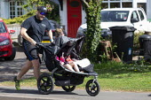 Coronavirus Pandemic, man exercising, running and pushing a double pram with two children and pet dog, Stratford-upon-Avon, Warwickshire - John Harris - 2020,2020s,child,CHILDHOOD,children,coronavirus,covid-19,DAD,DADDIES,DADDY,DADS,disease,DISEASES,dog,DOGS,epidemic,exercise,exercises,exercising,families,family,fat,father,FATHERHOOD,fathers,fitness,g