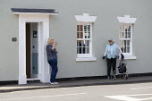 Coronavirus Pandemic. Women maintaining social distance whilst in discussion outside in the street, Stratford-upon-Avon, Warwickshire - John Harris - 16-04-2020