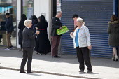 Coronavirus Pandemic. Bank worker helping customers to maintain social distance in the queue outside Lloyds Bank, King's Heath, Birmingham - John Harris - 16-04-2020