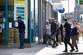 Coronavirus Pandemic. Customers trying to maintain social distance in a Poundland shop queue, King's Heath, Birmingham - John Harris - 16-04-2020