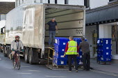 Workers loading contents of closed Debenhams store onto lorries, Stratford Upon Avon, Warwickshire - John Harris - 20-04-2020