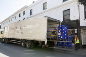 Workers loading contents of closed Debenhams store onto lorries, Stratford Upon Avon, Warwickshire - John Harris - 2020,2020s,bankrupt,bankruptcy,close,closed,closing,closing down,closure,closures,Debenhams,empty,HAULAGE,HAULIER,HAULIERS,HGV,hgvs,High St,High Street,LGV,LGVs,loading,lorries,lorry,outlet,outlets,pe