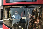 Coronavirus Pandemic. Bus Driver wearing face mask, Trafalgar Square, London - Duncan Phillips - 22-04-2020