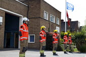 Firefighters holding a minute's silence at noon to remember fallen firefighters, Firefighters Memorial Day, Stratford Upon Avon Fire Station, Warwickshire - John Harris - 2020,2020s,adult,adults,annual,ceremonial,ceremonies,ceremony,dead,death,death at work,deaths,died,fallen,FBU,Fire,Fire and Rescue Service,Fire Brigade,Fire Station,Firefighter,firefighters,Firefighte