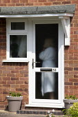 Woman on the phone during lockdown, Stratford Upon Avon, Warwickshire - John Harris - 04-05-2020