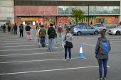 Coronavirus pandemic. Shoppers queuing, Sainsbury's supermarket, Finchley Road, London - Philip Wolmuth - 02-05-2020