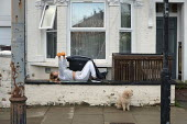 Covid-19 pandemic lockdown. Woman exercising with weights outside her flat in West Hampstead, London. - Philip Wolmuth - 2020,2020s,activities,animal,animals,canine,cities,City,coronavirus,covid-19,disease,DISEASES,dog,dogs,epidemic,exercise,exercises,exercising,FEMALE,fitness,flat,HEA,Health,home,homes,housing,keeping